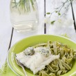 Codfish fillet and pasta — Stock Photo