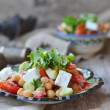 Stock Photo: Chickpeas and vegetebles salad.
