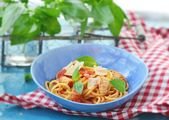 Spaghetti with calamary tomatoes and basil — Stock Photo