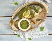 Baked dorado fish  with pesto sauce — Stock Photo