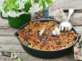 Homemade blueberry crumble on  wooden table — Stock Photo