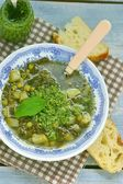 Vegetable soup with pesto sauce — Stock Photo