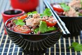 Salad from rice noodles with a tuna — Stock Photo