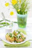 Baked potato with green pea — Stock Photo