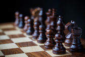 Small wooden chess pieces — Stock Photo