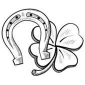 Lucky horseshoe and clover sketch — Stock Vector