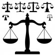 Justice scales in vector silhouette — 图库矢量图片