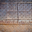 Stock Photo: Old door rusty metal cover with rivets