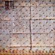 Old door rusty metal cover with rivets — Stock Photo