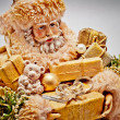Stock Photo: Santa Claus with gifts. Christmas background.