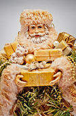 Santa Claus with gifts. Christmas background. — Stock Photo