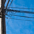 Electric pole with cables — Stock fotografie