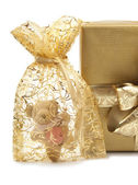 Golden Presents and Teddy-bear — Stock Photo