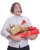 Hands full of presents — Stock Photo