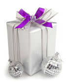 Christmas present with ornaments — Stock Photo
