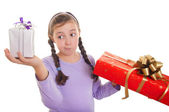 Little girl with presents — Stock Photo