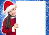Happy Christmas Girl holding blank banner — Stock Photo