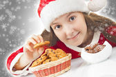 Happy Christmas girl eating Christmas cookies — Stock Photo