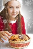 Beautiful Christmas girl wants to eat cookies — Stock Photo
