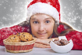 Happy Christmas girl wants to eat cookie — Stock Photo
