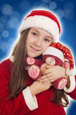 Beautiful Christmas Girl with teddy bear — Stock Photo