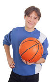 Teenage boy holding a basketball — Stock Photo