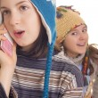 Beautiful young girl in warm winter clothes speaking on a mobile — Stock Photo #19184297