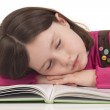 Little girl sleeping on a open book — Stock Photo #21892683