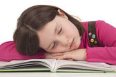 Little girl sleeping on a open book — Stock Photo