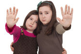 Two little girls gesturing stop — Stock Photo