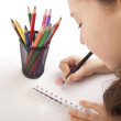 Beautiful girl is drawing with color pencils — Stock Photo
