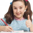 Beautiful girl drawing and showing OK — Stock Photo #22004283