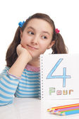 Beautiful girl showing number four — Stock Photo