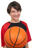 Portrait of a handsome smiling basketball player — Stockfoto