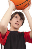 Basketball player throwing a basketball — Stock Photo