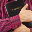 Man hugging a Bible — Stock Photo
