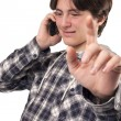 Teenage boy talking on mobile phone — Stock fotografie