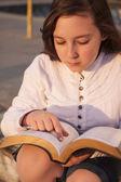 Beautiful girl reading holy bible — Stock Photo