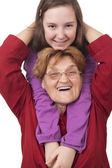Grandmother and granddaughter hugging — Stockfoto