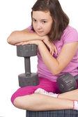 Tonårsflicka anläggning vikt — Stockfoto