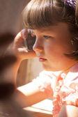 Little girl talking on cell phone — Stock Photo