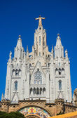 Tibidabo church on mountain in Barcelona with christ statue overviewing the city — Stock Photo