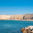 Mandraki harbor and a beach, Rhodes, Greece. — Stock Photo