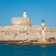 The old fortress and the lighthouse on Rhodes island, Greece. — Stock Photo