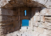 Medieval loophole in the old town on an island Rhodes, Greece. — Stock Photo