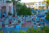 RHODES ISLAND, GREECE- JULY 1: Holidaymakers have their drinks in a restaurant of Mitsis Rhodos Village hotel on July1,2013. Rhodes Island, Greece. — Stock Photo