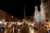 ROME-AUGUST 7: Piazza Navona on August 7, 2013 in Rome. Piazza Navona is a city square built on the site of the Stadium of Domitian in 1st century AD, in Rome, Italy. — Stock Photo