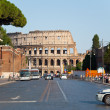 ROME-AUGUST 8: The Via dei Fori Imperiali on August 8,2013 in Rome, Italy. The Via dei Fori Imperiali is a road in the center of the city of Rome, that from the Piazza Venezia to the Colosseum. — Stock Photo