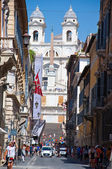 ROME-AUGUST 6: Via Condotti on August 6, 2013 in Rome. Via Condotti (officially Via dei Condotti) is a busy and fashionable street of Rome, Italy. — Stock Photo