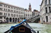 VENICE-JUNE 15: Gondola on the Venetian canal on June 15, 2012 in Venice, Italy. — Stock Photo